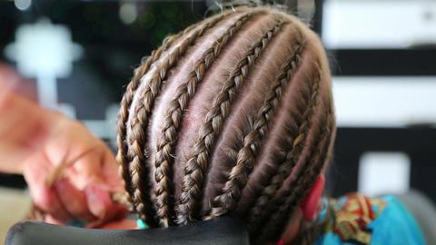 Hairdresser Hands Weaving A Dreadlocks For Little  stock footage
