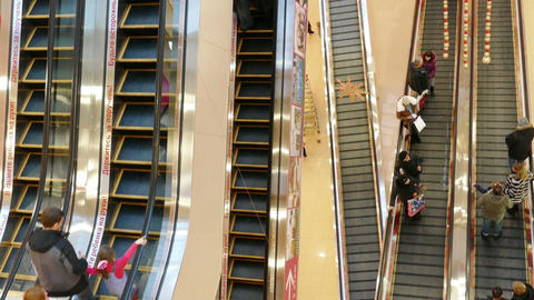 People in motion on escalators at modern shopping  Footage
