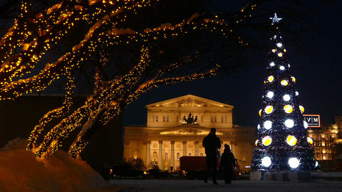 Bolshoi Theatre and street lights on the trees and Live Action