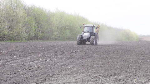tractor with sprayer travels on the road Live Action