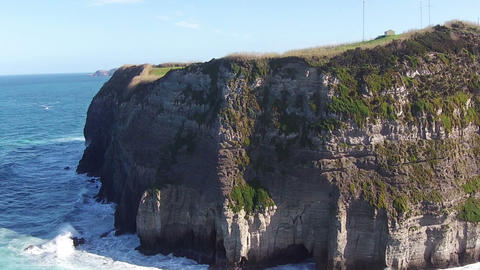Flying over the High Cliffs and Ocean Waves Footage