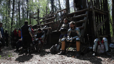 Knights Take A Rest Between Battles In Full Armor stock footage