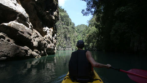 man rowing kayak and floats along the gorge Footage
