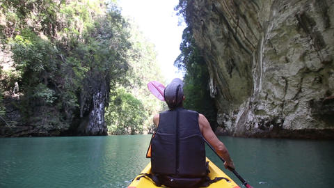 man floats kayak and looks around kayak Footage