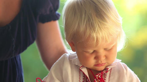 Blonde Child In Vyshyvanka Watching Cartoon stock footage