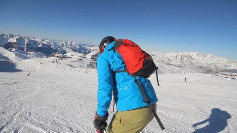 Alpine skier skiing slalom, blue sky on background Footage