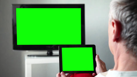 Man With Green Screen Ipad Watches Tv Live Action