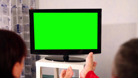 Man And Woman Watching Television. Green Screen stock footage