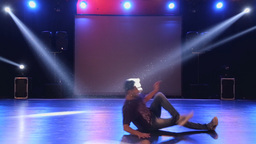 Hip-hop dancer dances on stage in the club Footage