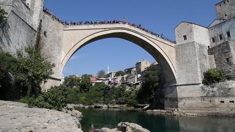 Traditional Jump From Old Bridge In Mostar stock footage
