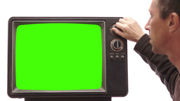 Male Turning Channel On Vintage TV stock footage