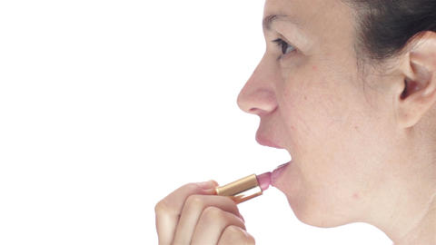 Side-view Of Woman Applying Lipstick stock footage