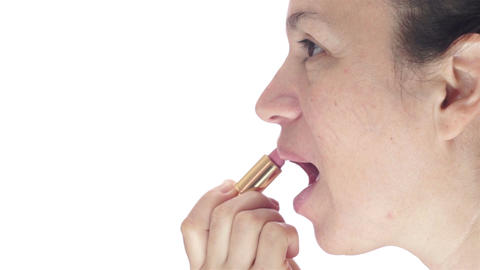 Side-view of Woman Applying Lipstick Stock Video Footage
