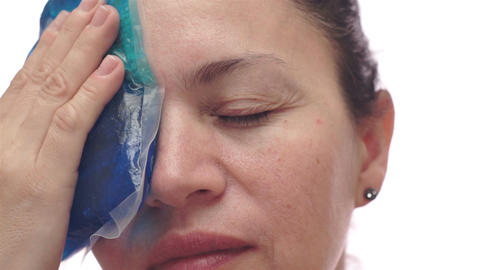 Woman With Cold Pack For Migraine Footage