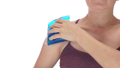 Woman Puts Cold Pack on Shoulder Front View Live Action