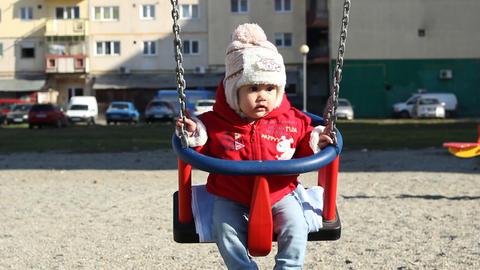 Baby in Neighbourhood Swing Footage