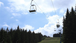 Chairlift over Fir Forest Footage