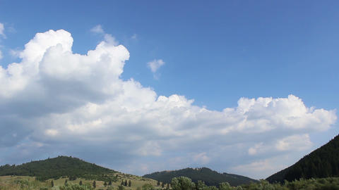 Clouds Shaping over Forested Hills Footage