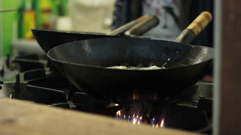 Cook Boiling In Black Pan stock footage