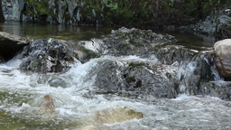 Foamy Water Washes Stones stock footage