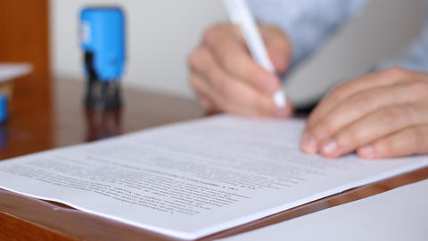Man Signing and Stamping Documents Footage