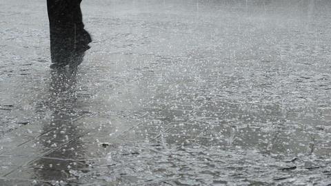 Man Walks through the Hail Rain Footage