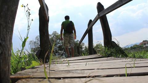 Passing A Wooden Footbridge Footage