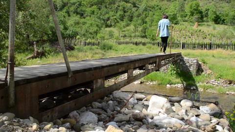 Person Is Crossing A Footbridge stock footage