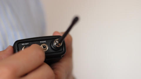 Power On Lavalier Microphone Transmitter stock footage