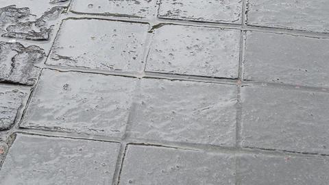 Rain Drops on Paved Street Footage