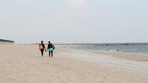 Two Girls Walking on Beach Footage