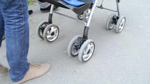 Woman Pushing Baby Stroller Stock Video Footage