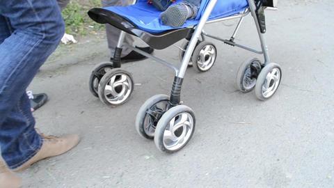 Woman Pushing Baby Stroller Footage