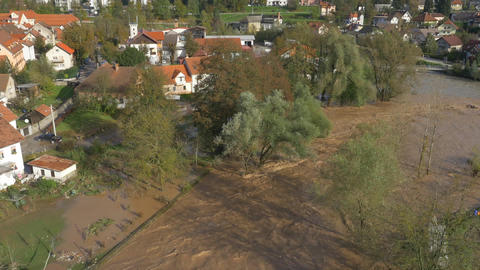 AERIAL: Flooded river running through suburban tow Footage