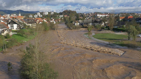 AERIAL: River Flooding The Town stock footage