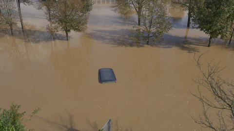 AERIAL: Cars trapped in flooded parking Footage