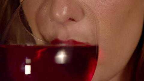 SLOW MOTION CLOSE UP: Woman with red lips drinking Footage