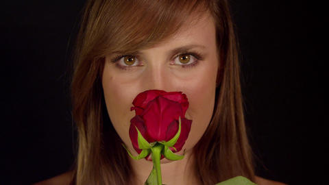 Romantic woman smelling red rose and smiling Footage