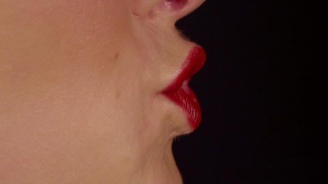 SLOW MOTION CLOSE UP: Woman kiss and smile Live Action