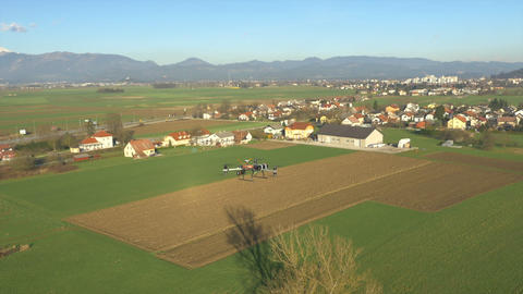 AERIAL: Drone with camera flying above the fields Footage
