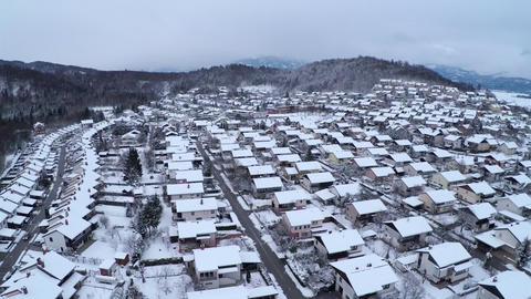 AERIAL: Flying above snowy suburbs Footage