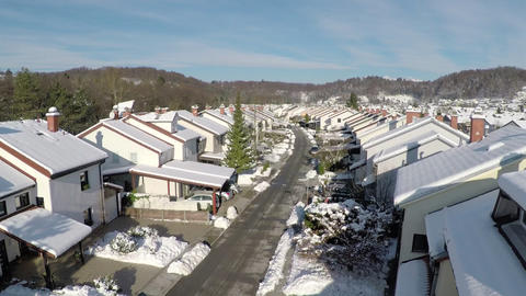 AERIAL: Sunny suburbs in winter Footage