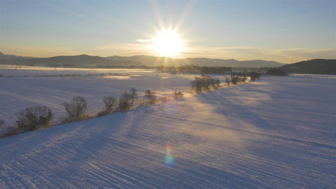 AERIAL: Winter landscape covered in snow at sunset Footage