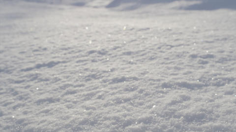CLOSE UP: Fresh snow glittering in the sun Footage
