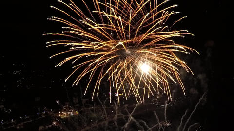 AERIAL SLOW MOTION: Big fireworks above city Footage