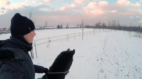 Young woman cantering with big black horse Footage