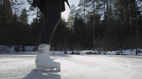SLOW MOTION CLOSE-UP: Female spinning on ice skate Live Action
