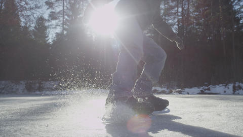 SLOW MOTION: Ice Skater breaking and spraying ice  Footage