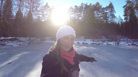 CLOSE UP: Cheerful woman spinning on ice skates in Footage
