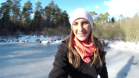 CLOSE UP: Young woman ice skating outdoors selfie Live Action
